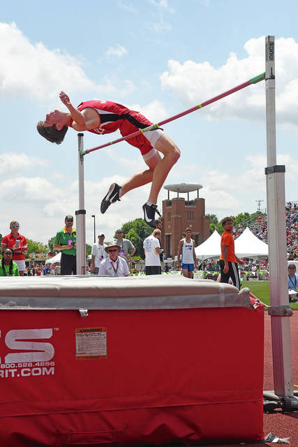 Ben Robinson|GoBuccs.com Newton's Cameron Stine goes over the bar in the high jump Friday at Jesse Owens Memorial Stadium.