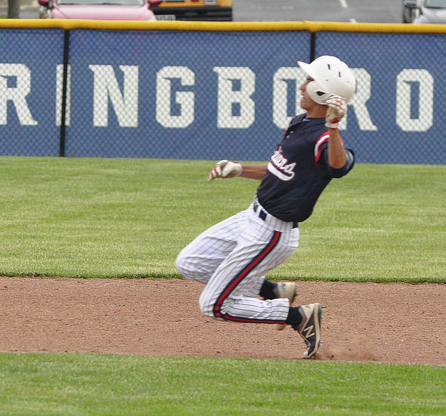 Rob Kiser Miami Valley Today Piqua's Owen Toopes slides into second base against Springboro Thursday in Division I sectional action.