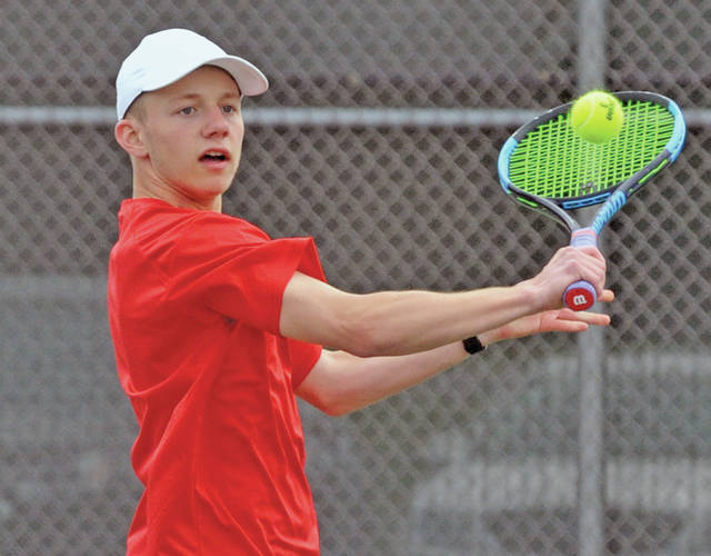 Josh Brown|Miami Valley Today file Troy's Jackson Goodall hits a backhand during a match earlier this season. The Trojans' GWOC American North Division title in tennis helped Troy put away its third straight division all-sports trophy for the 2018-19 school year.
