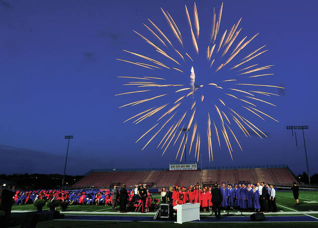 Mike Ullery | Miami Valley Today The Piqua High School Class of 2019 goes out with a bang as a fireworks display fills the sky over Alexander Stadium/Purk Field. The display was set to accompanythe Piqua Show Choir, <em>The Company</em>, as they performed <em>Firework</em> during the commencement ceremony.