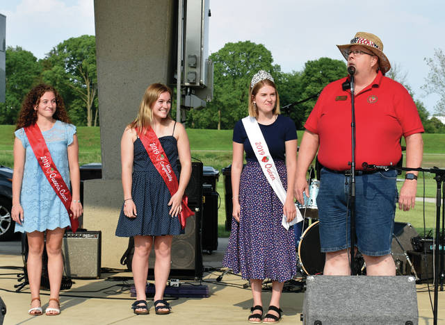 Chairman Bruce Adamson, far right, introduces the 2019 Strawberry Queen Abby Johnson, and her court, KatieRobinson, and Josalyn Abrams, as the 2019 Troy Strawberry Festival kicks off at Treasure Island on Friday.