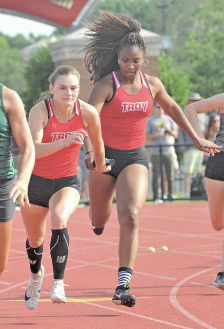 Josh Brown|Miami Valley Today Troy's Annah Stanley passes the baton to Brennah Hutchinson in the 4x100 relay at the Division I state meet Saturday at Jesse Owens Memorial Stadium.