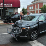 Heavy damage, minor injury in downtown crash