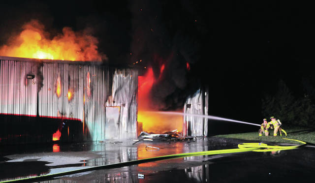 Troy firefighters battle a major fire at Playcare Playground Specialists in the 2500 block of West St. Rt. 55 in Troy on Wednesday night.