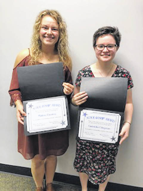 Provided photo Gabriella Clingman and Mallory Dunlevy, both graduates of Newton High School, received scholarships from the Miami County Retired Teachers Association.