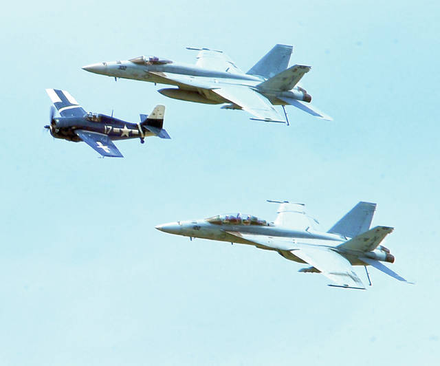 The United States Navy Legacy Flight featured a pair of FA-18 Super Hornets and a rare Grumman F4F Wildcat fighter.