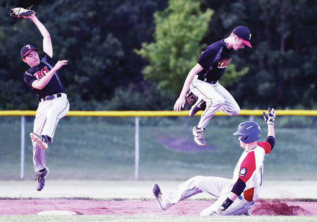 Luke Gronneberg|Aim Media SidneyPost 217's Jarred Seigle slides safely into secon as Troy's Kyle Evans and Austin Kendall jump for the ball at Sidney on Tuesday.