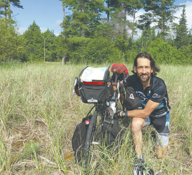 Provided photo Mark Looney, a former Troy resident, recently completed a 4,200-mile bicycle journey around each of the Great Lakes.