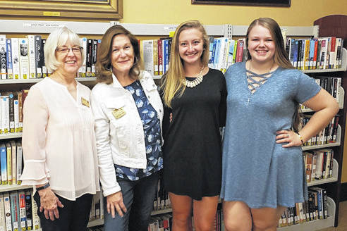 Provided photo From left, Friends of the Piqua Public Library Scholarship Committee representatives Barbara Spraggs and Julia Benkert, and winners Kelsey Bachman and Brieanna Werling. Not shown is committee representative Christine Casto.