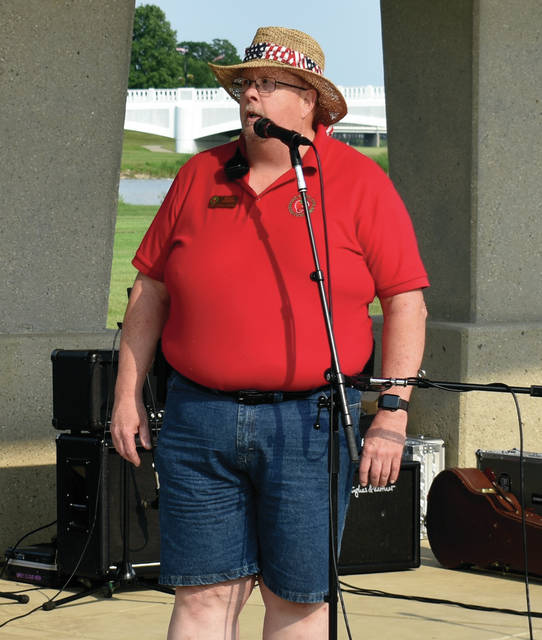 Festival Chairman Bruce Adamson welcomes guests to Friday's opening of the 2019 Troy Strawberry Festival