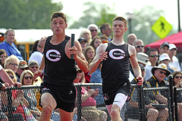 Ben Robinson|GoBuccs.com Covington's Gray Harshbarger takes off after getting a handoff from Alex Shaffer in the 800-meter relay Saturday.