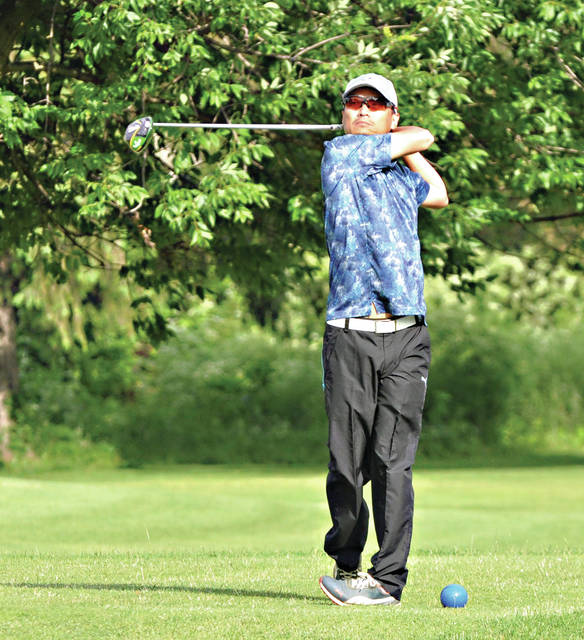 Rob Kiser|Miami Valley Today Jacky Chen watches his tee shot on the first hole at the Troy City Championship Saturday at Miami Shores Golf Course.