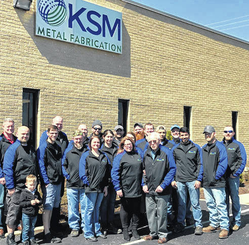 Provided photo KSM Metal Fabrication employees for a photo in honor of the company's 40th anniversary in business.