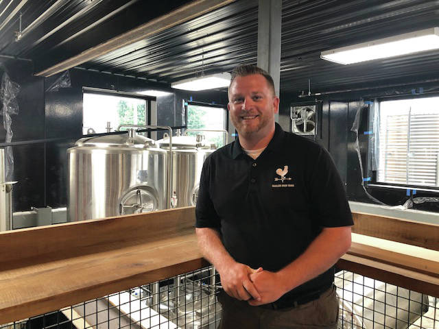 Anthony Scott, co-owner of the Moeller Brew Barn's Tabernacle Brewing Company, stands in front of stainless steel tanks located in the back part of the brewery located at 214 West Main Street, in Troy. Scott said the finishing touches are being made at the former historic First Lutheran Church and will open to the public in the coming weeks.