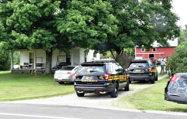 Miami County deputies investigate a reported break-in at a home in the 8000 block of East St. Rt. 55 on Tuesday.