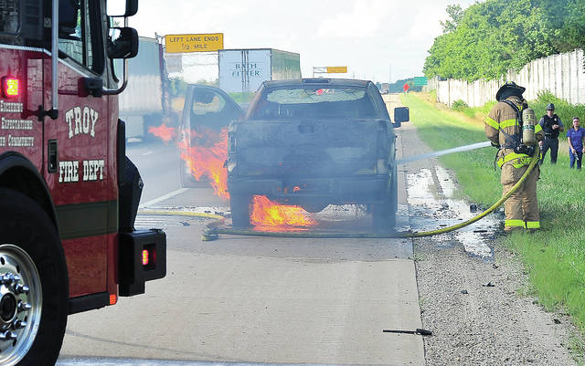 Troy firefighters battle a stubborn truck fire on northbound I-75, just north of the St. Rt. 41 exit (Mile Marker 74) on Thursday afternoon. The call cam e in shortly after 5:15 p.m.. The Ohio State Highway Patrol and Troy Police responded to control traffic while firefighter extinguished the blaze. No one was injured. Fire units were on the scene for around 90 minutes. ©2019 Miami Valley Today. All rights reserved