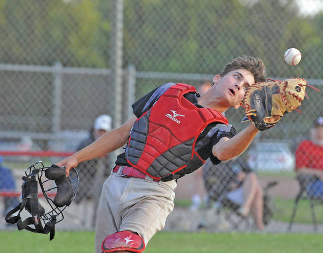 Josh Brown|Miami Valley Today Troy Post 43 catcher Andy Wargo tracks down a pop up against Greenville Post 140 during the loser's bracket final of the American Legion Region 2 tournament Tuesday at Duke Park.