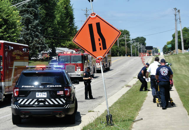 Piqua medics tend to a pair of juvenile bicyclists who crashed on Looney Road on Wednesday afternoon. Both boys sustained significant injuries and were transported to Upper Valley Medical Center for treatment. Piqua police said that the two friends were riding side-by-side northbound on the sidewalk when their handlebars apparently became entangled, causing them to crash. ©2019 Miami Valley Today. All rights reserved