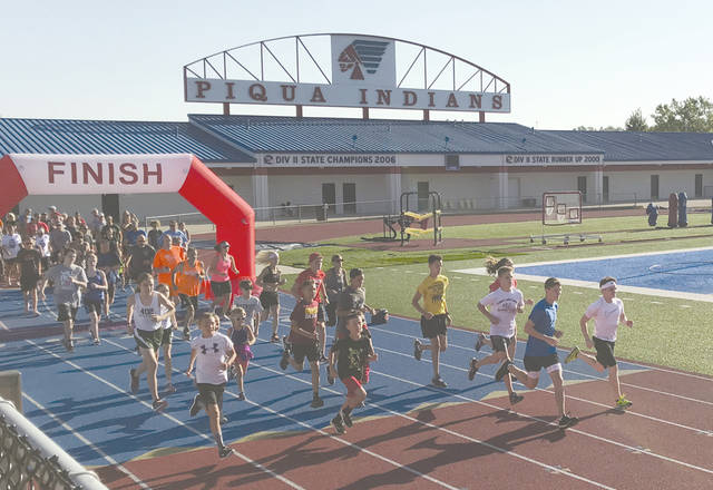 Provided photo The Piqua Optimists Club hosted its annual Bob Mikolajewski Memorial 5K Run/Walk on Saturday, July 13 at Piqua High School.