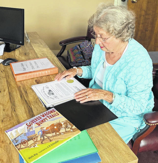 Virginia Kinney looks through the assortment of documents she has collected throughout her journey to get the sugar cookie officially declared the state dessert of Ohio. Kinney has been working toward the goal for the past 10 years.