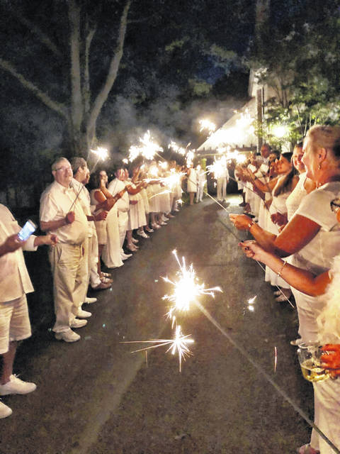 "Provided photo ""A Night in White,"" a fundraiser for the Piqua High School show choir ""The Company,"" is set to return on Sept. 1. Last year's inaugural event ended the evening with a tunnel of sparklers outside of the Orrmont Estate."
