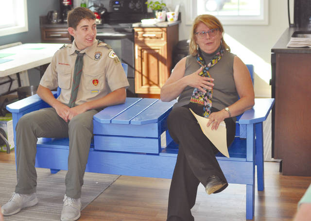 Provided photo Charlie Knostman, Eagle Scout candidate, and Carol Jackson, executive director of Partners In Hope, sit on the bench he presented to Partners In Hope.