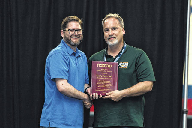 Provided photo Troy Christian Schools Guidance Director Steve Peterson was recently awarded the Guidance Counselor of the Year award at the Annual Conference of the North American Coalition for Christian Admissions Professionals.