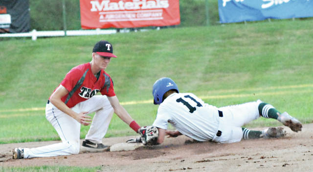 Rob Kiser|Miami Valley Today Troy Post 43's Austin Kendall puts a tag on Greenville Post 140's Jarin Young at second base.