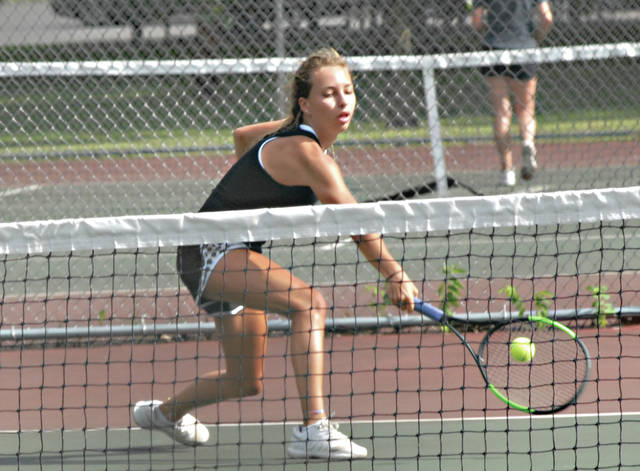 Rob Kiser|Miami Valley Today Dakota Schoreder reaches for a backhand against Hannah Fugate at Troy City Park Friday.