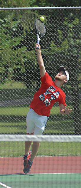 Rob Kiser|Miami Valley Today Sean Dippold launches a serve during a doubles match in the Frydell Junior Tournament Thursday at Troy City Park.
