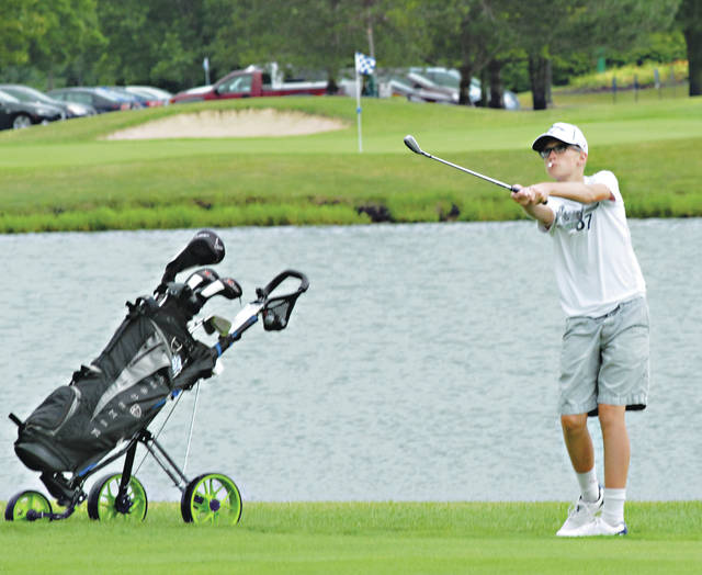 Rob Kiser|Miami Valley Today Evan Hensler chips on to the second green Wednesday at Echo Hills.