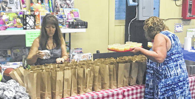 Courtesy photo Volunteers prepare Troy Summer Lunch Program lunches recently at The Rec in Troy.