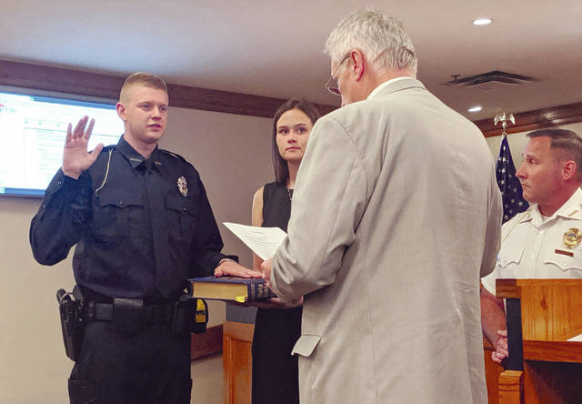 Cecilia Fox | For Miami Valley Today Luke Veldman was sworn as the department's newest officer Monday night by Mayor Joe Gibson.