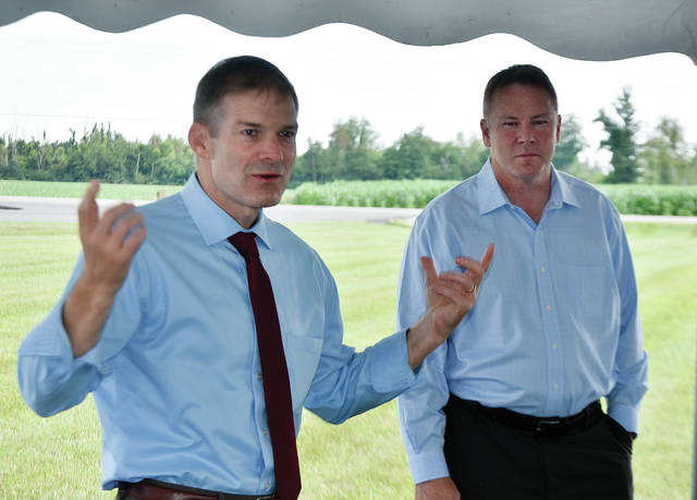 Ohio Congressman Jim Jordan, (R- Ohio 4th District), left, and Congressman Warren Davidson, (R-Ohio 8th District) answer questions during a visit hosted by the Severs family at PSC Crane & Rigging in Piqua on Wednesday. ©2019 Miami Valley Today. All rights reserved