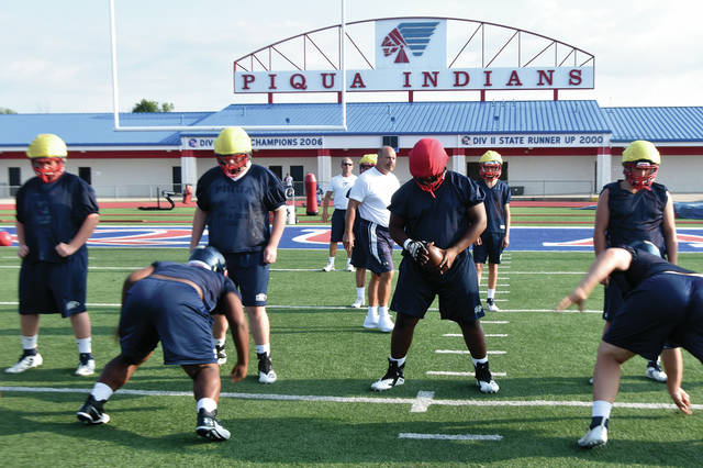 The Piqua Indians line up to begin their first official practice of the 2019 football season on Thursday morning at Alexander Stadium/Purk Field.