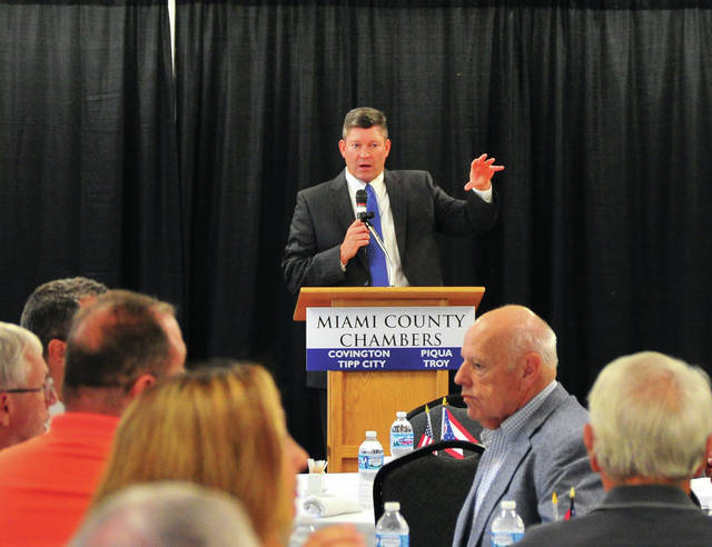 Jay Moeller, chairman of the Miami County Chambers Legislative Committee, addresses attendees to Friday's Miami County Legislative Luncheon at Hobart Arena's Bravo Room.