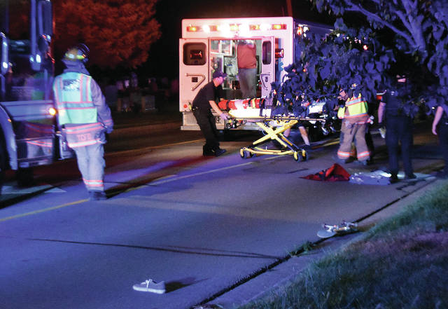 A skateboarder is wheeled to a waiting medic from Elizabeth Twp. after being struck by a vehicle while skateboarding down South Hyatt St. in Tipp City around 11:30 p.m. on Wednesday. Tipp City Police are investigating the crash. The name and age of the victim has not been released. His condition is not known. The driver was not injured. ©2019 Miami Valley Today. All rights reserved