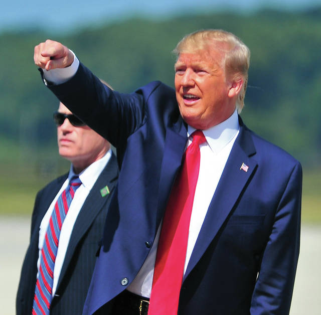 President Donald Trump waves to well-wishers on the ramp at Wright-Patterson Air Force Base as he readies to head to downtown Dayton to visit victims, families, and first responders who were a part of this past weekend's Oregon District shootings. ©2019 Miami Valley Today. All rights reserved