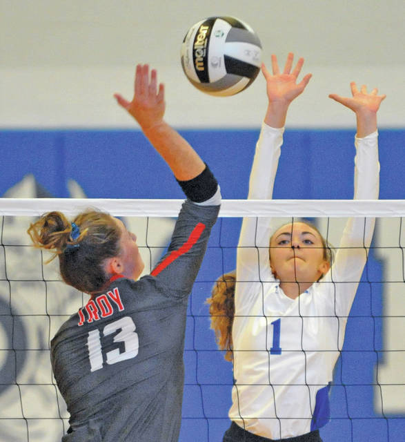 Josh Brown|Miami Valley Today Troy's Lauren Schmitz goes up for a kill as Miami East's Kylee McKinney tries to block Saturday.