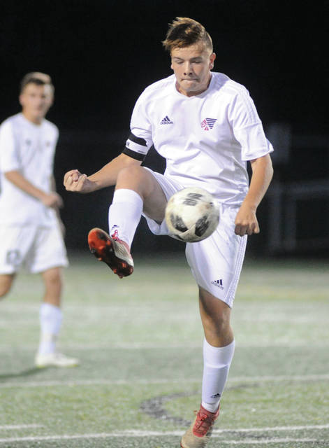 Mike Ullery|Miami Valley Today file Piqua's Jarret Powers controls the ball against Sidney last year.