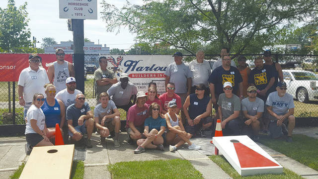 Provided photo Members of the corn hole teams pose at the tournament, held Sunday, Aug. 11.