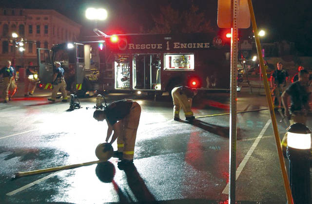 Provided photo Fire crews begin to pack up their gear after fighting a fire at 2 E. Main St., Troy, the site of the new Haren's Market that is set to open in the coming weeks.