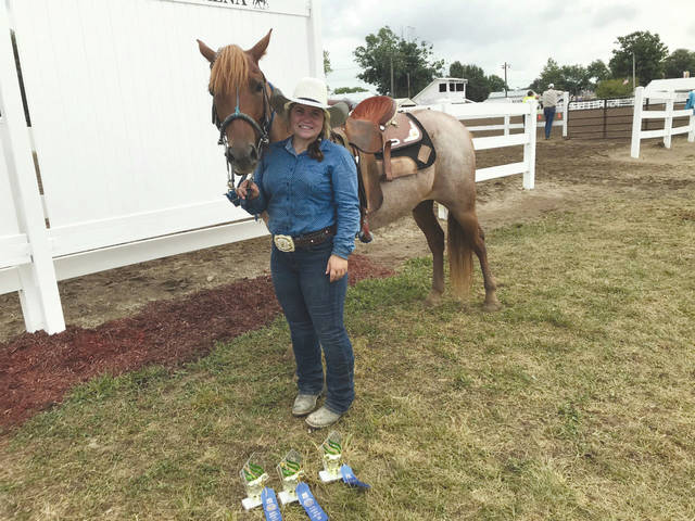 Melody Vallieu | Miami Valley Today Haylie Jackson of Covington and a member of the Mane Express-H Club, won first place in Pole Bending, Barrels and Cones and Keyhole. She is the daughter of Lacey Apple.
