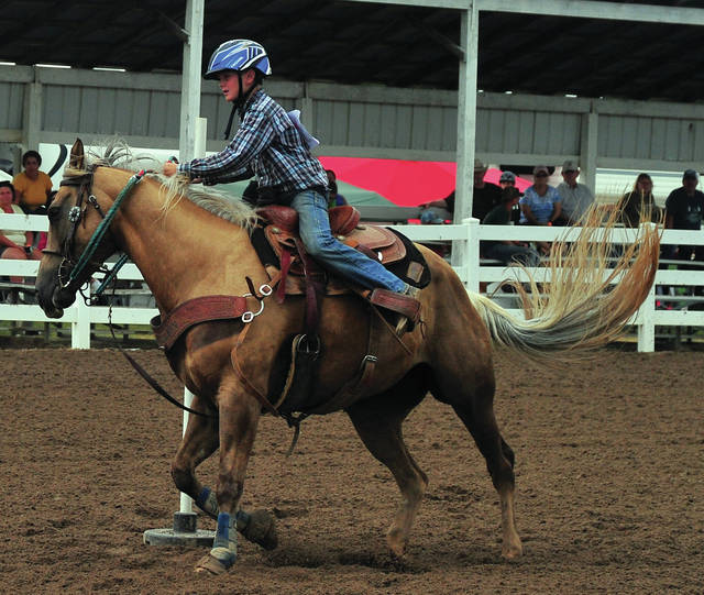 Hunter McMillion of Covington competes in the Speed and Control event in the horse arena on Tuesday.