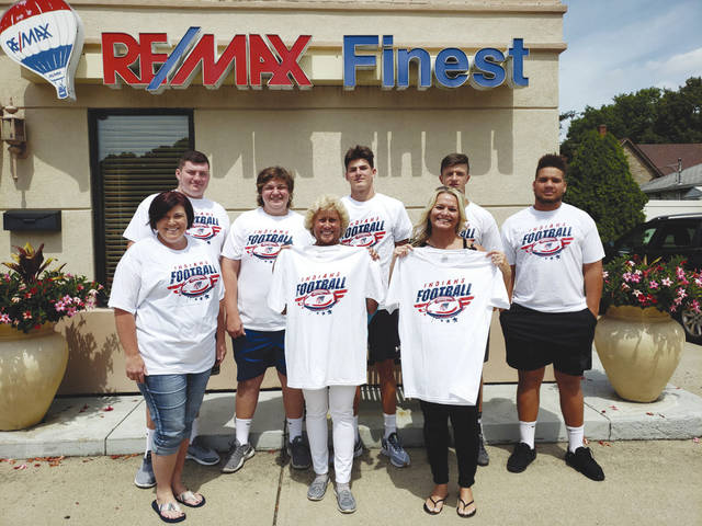 Provided photo Kathy Henne Remax, including Kathy Henne, Brandi Lawson and the rest of the Remax team, recently donated T-shirts to the Piqua Football Mom's Club. Pictured are front row, from left, Jamey Hepner, Kathy Henne and Brandi Lawson. Back row, Riley Hill, Jacob Hepner, Blaine Ouhl, Zane Beougher, and Jerell Lewis.