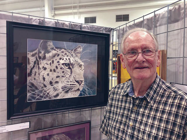 "Provided photo First place winner Tom Kinarney with his pencil drawing ""Leopardus."""
