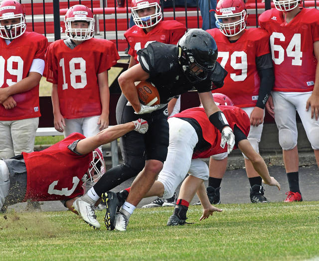 Ben Robinson|GoBuccs.com Covington's Duncan Cooper fights for yardage Saturday.