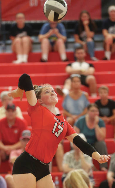 Lee Woolery|Miami Valley Today Troy's Lauren Schmitz goes up for a kill Thursday against Piqua.