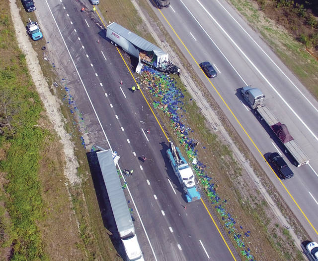 Pepsi products lay strewn along southbound I-75 in Piqua following a crash near the 83 mile marker on Tuesday morning.