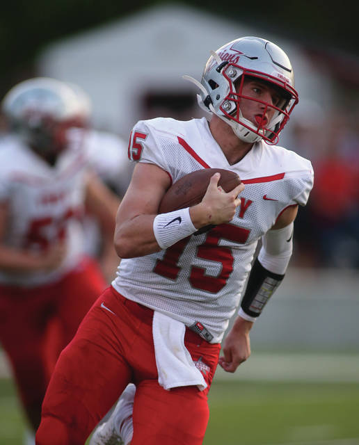 Lee Woolery|Miami Valley Today Troy quarterback Brayden Siler breaks away for a big gain Friday night against Tippecanoe.